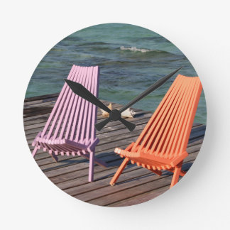Photo of seaside chairs round clock