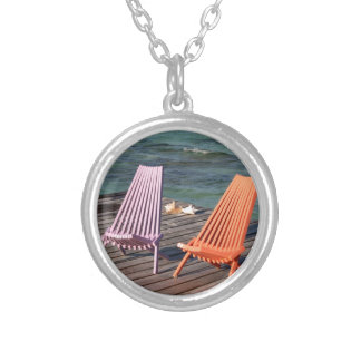 Photo of seaside chairs round pendant necklace
