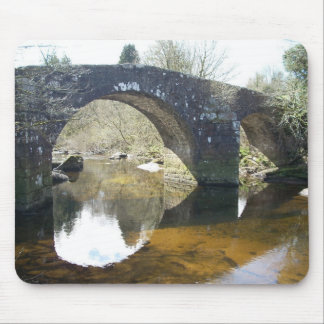 Photo of stone bridge over tranquil stream mouse pad