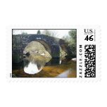 Photo of stone bridge over tranquil stream stamp