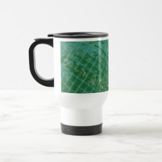 Photo picture of green plastic cover. travel mug