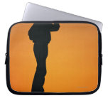 Photo, silhouette of a cowboy with his hand on laptop computer sleeve