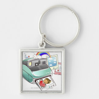 Photograph coming out of an instant camera keychain