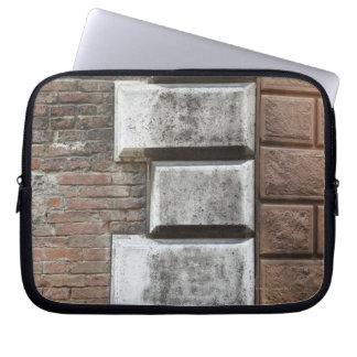 Photograph of an old brick wall in Siena Italy. Laptop Sleeves