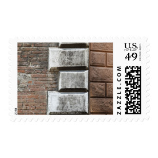 Photograph of an old brick wall in Siena Italy. Stamp