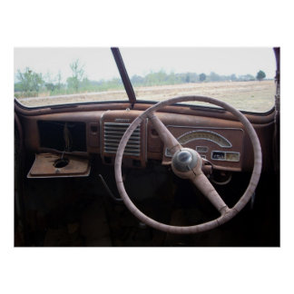 Photograph of old car interior with rusty gauges poster