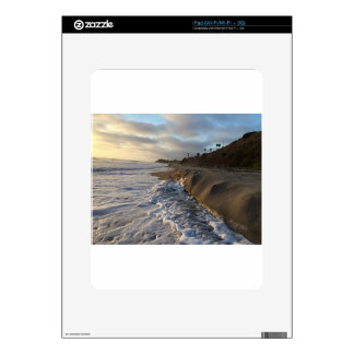 Photograph of the waves hitting the sand iPad skin