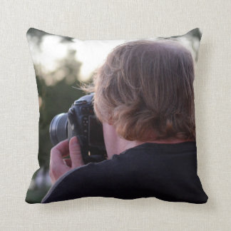 photographer taking picture male back of head throw pillow