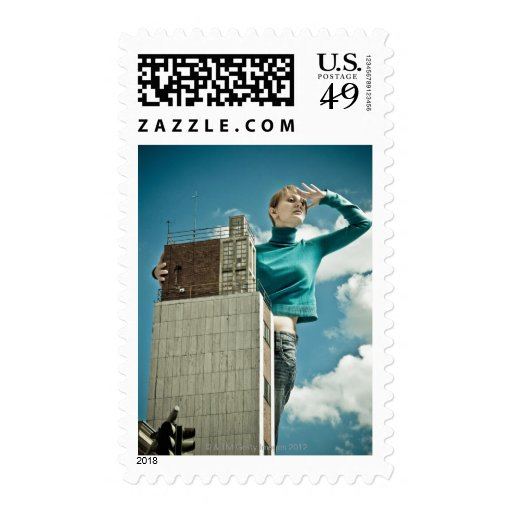 photomontage of young girl on city shot stamp