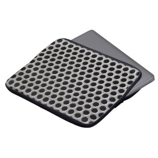 Photorealistic metal grill dot pattern close up computer sleeve