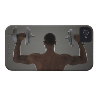 Physically fit man lifting dumbbells 2 iPhone 4 cover
