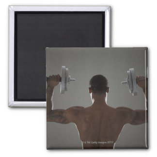 Physically fit man lifting dumbbells 2 2 inch square magnet