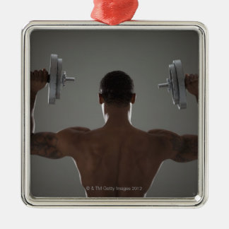 Physically fit man lifting dumbbells 2 metal ornament