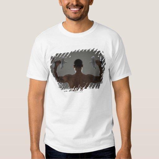 Physically fit man lifting dumbbells 2 t-shirt