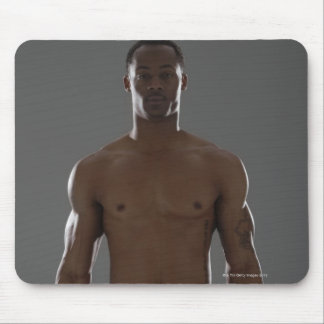 Physically fit man lifting dumbbells mouse pad