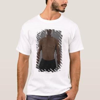 Physically fit man lifting dumbbells T-Shirt
