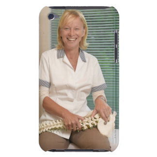 Physiotherapist with model of spine barely there iPod case