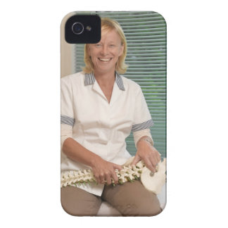 Physiotherapist with model of spine Case-Mate iPhone 4 case