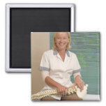 Physiotherapist with model of spine refrigerator magnets