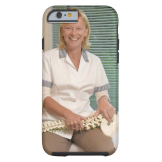 Physiotherapist with model of spine tough iPhone 6 case