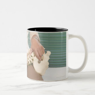 Physiotherapist with model of spine Two-Tone coffee mug