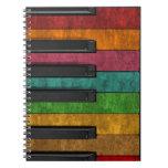 Piano antiguo colorido fresco del efecto del grung cuadernos