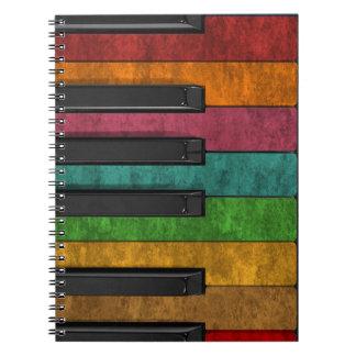 Piano antiguo colorido fresco del efecto del grung libretas espirales