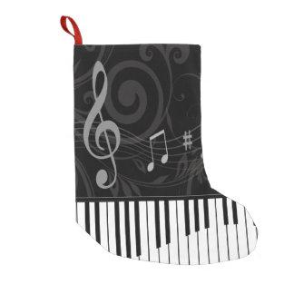 Piano caprichoso y notas musicales calcetín de navidad pequeño