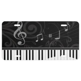 Piano caprichoso y notas musicales placa de matrícula