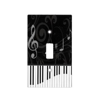 Piano caprichoso y notas musicales tapa para interruptor