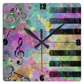 Piano colorido de las salpicaduras frescas de los  reloj cuadrado