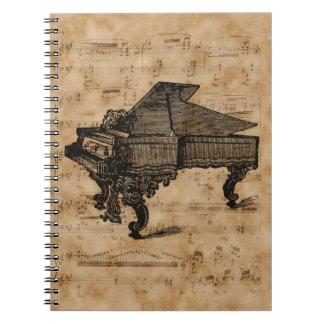 Piano de cola antiguo en la página de la hoja de libreta