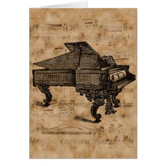Piano de cola antiguo en la página de la hoja de tarjeta de felicitación