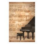 Piano de cola con las notas de la música papelería