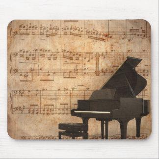 Piano de cola con las notas de la música tapete de ratón