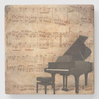 Piano de cola con partitura posavasos de piedra