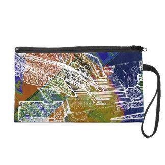 piano hands invert over orange guitar neck hands wristlet purse