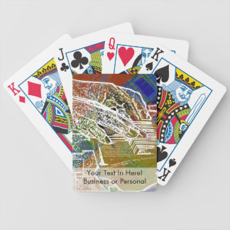 piano hands invert over orange guitar neck hands bicycle playing cards