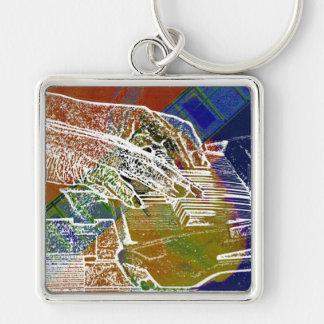 piano hands invert over orange guitar neck hands key chains