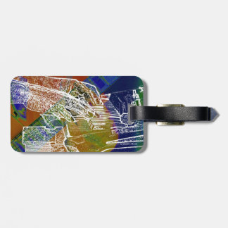piano hands invert over orange guitar neck hands luggage tag