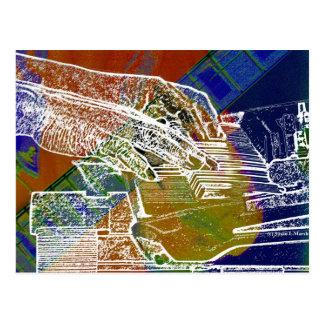 piano hands invert over orange guitar neck hands postcard