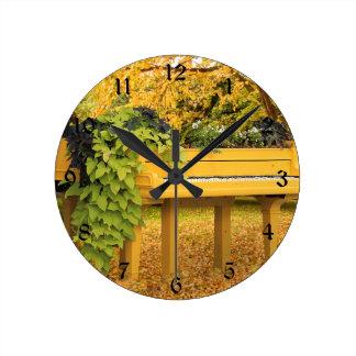 Piano in autumn woods round clock