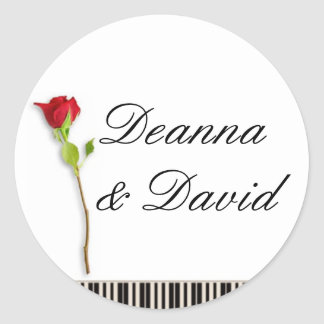 Piano keys and a rose classic round sticker