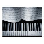 Piano Keys and Music Book Postcard