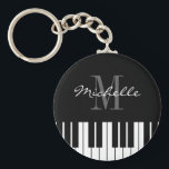 "Piano keys keychain for kids, pianist or teacher<br><div class=""desc"">Grand piano keys keychain for kids,  pianist or teacher. Cute round key chain with elegant name monogram. Monogrammed accessory for men women and kids. Classical instrument keyboard design for piano instructor,  music lessons etc. Fun black and white monogrammed party favor.</div>"