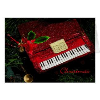 Piano rojo del brillo de la tarjeta de Navidad