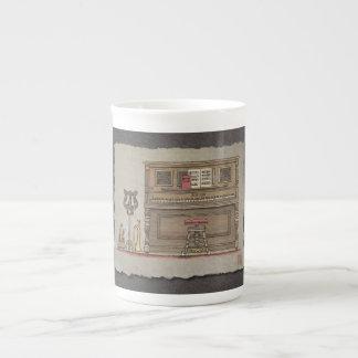 Piano vertical viejo taza de té