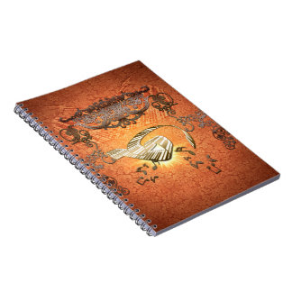 Piano with kay notes on decorative background spiral notebook