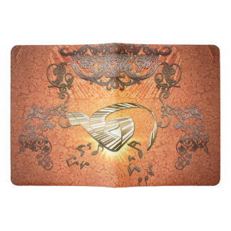 Piano with kay notes on decorative background extra large moleskine notebook cover with notebook