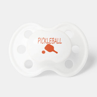 pickleball w paddle and ball dark orange pacifier